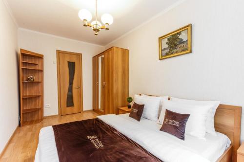 Кровать или кровати в номере InnDays on Sevastopolskaya