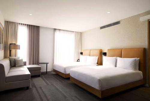 A bed or beds in a room at Hyatt Place Melbourne, Essendon Fields
