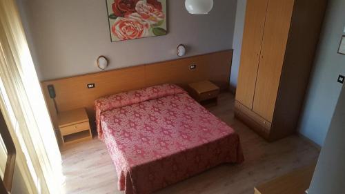 Postel nebo postele na pokoji v ubytování Hotel Sole