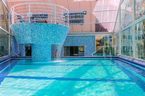 The swimming pool at or near Golden Park Campos do Jordão