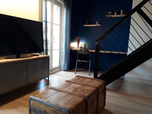 A television and/or entertainment centre at le République