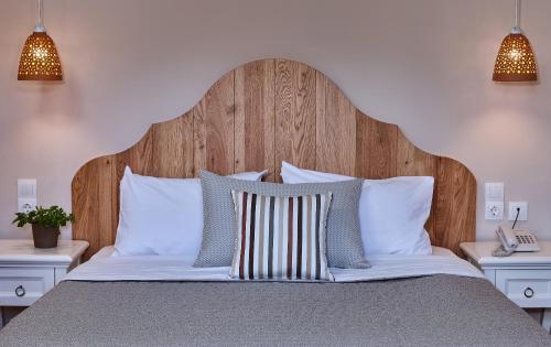 Een bed of bedden in een kamer bij Marni Village
