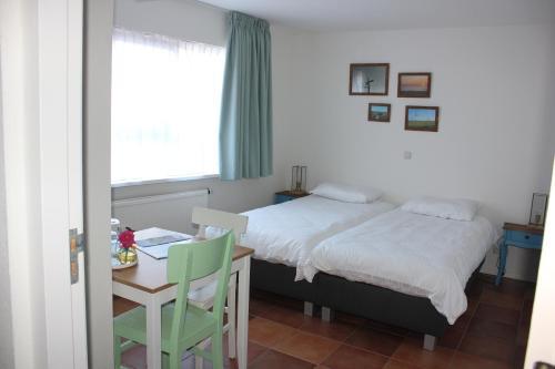 Un ou plusieurs lits dans un hébergement de l'établissement Bluesheep-texel