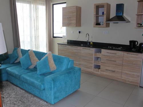 A kitchen or kitchenette at Flic en Flac Beach Apartment