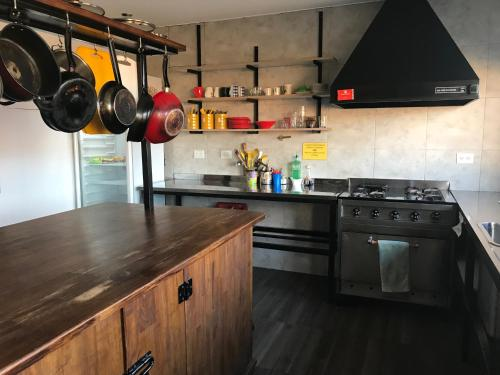 A kitchen or kitchenette at Folk Hostel