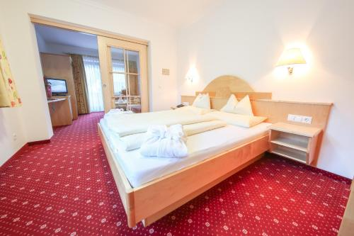 Ein Bett oder Betten in einem Zimmer der Unterkunft Superior Hotel Persal