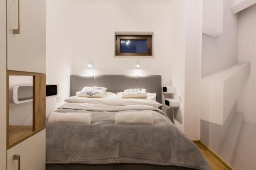 Łóżko lub łóżka w pokoju w obiekcie Banialuka Apart
