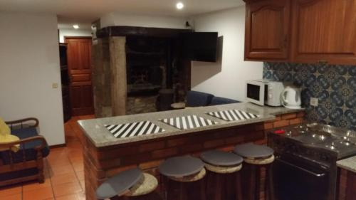 A kitchen or kitchenette at Angelas - Casa da Galega