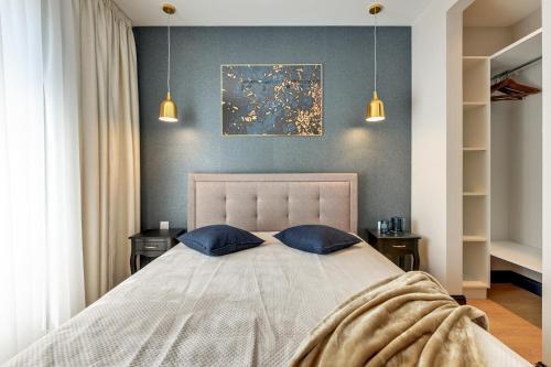 Łóżko lub łóżka w pokoju w obiekcie Tartaczna Suite