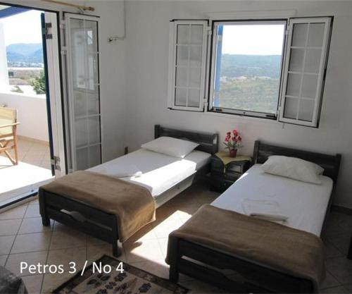 A bed or beds in a room at Petros Studios Kythera