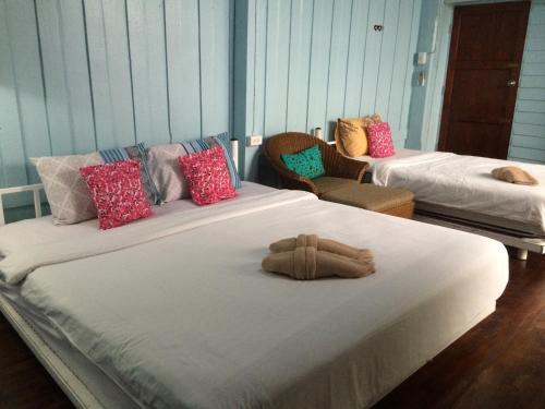 A bed or beds in a room at Goodmorning by Tamarind