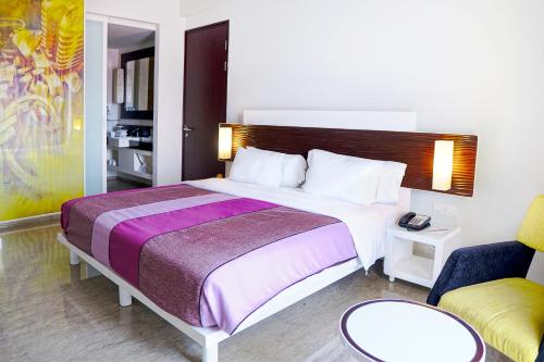 A bed or beds in a room at Sensa Hotel Bandung