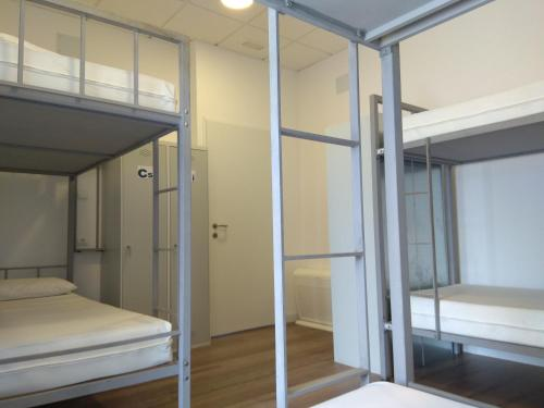 A bunk bed or bunk beds in a room at Check In León