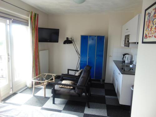 Ein Sitzbereich in der Unterkunft villa Flore, studio's