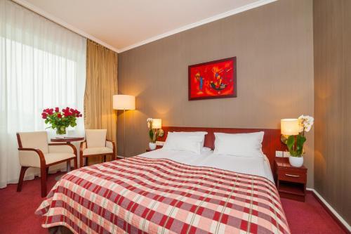 Letto o letti in una camera di Premier Kraków Hotel
