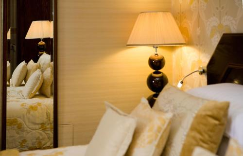 A bed or beds in a room at Armathwaite Hall Hotel & Spa