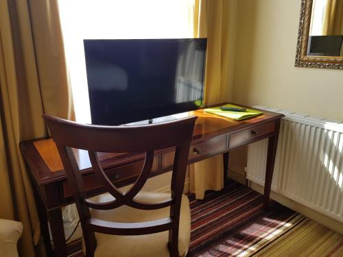 A television and/or entertainment center at Prom Hotel