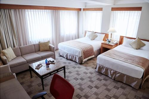 A bed or beds in a room at The Kitano Hotel New York
