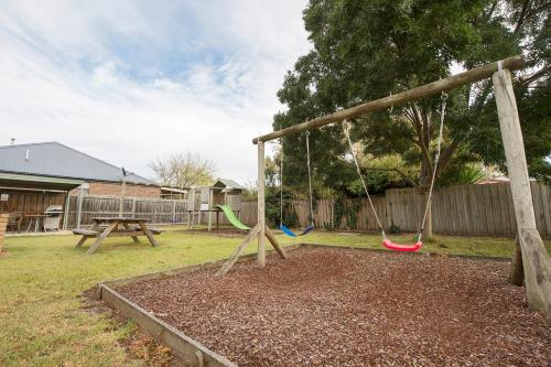 Children's play area at Rose Garden Motel
