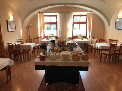 Reštaurácia alebo iné gastronomické zariadenie v ubytovaní V Penzión