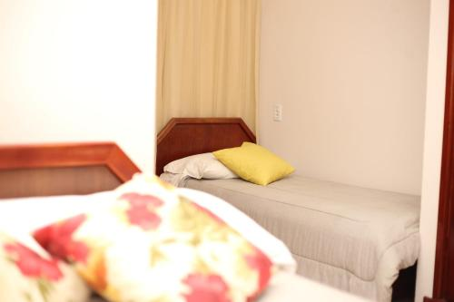 A bed or beds in a room at Hotel Daieli