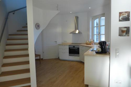 A kitchen or kitchenette at Ferienwohnung am Eifelsteig