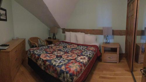 A bed or beds in a room at Boathouse Country Inn