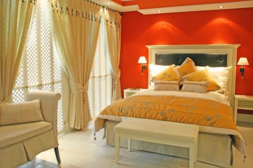 Ein Bett oder Betten in einem Zimmer der Unterkunft Hotel La Casa