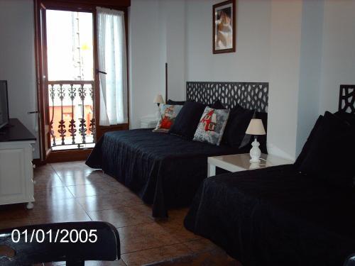 A bed or beds in a room at Apartamentos los Balcones