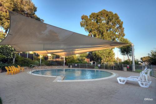 The swimming pool at or near Lavi Kibbutz Hotel
