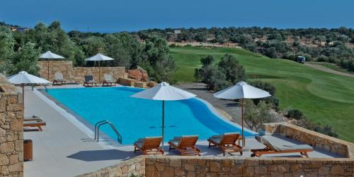 A view of the pool at Crete Golf Club Hotel or nearby