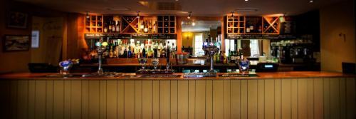 The lounge or bar area at Beambridge Inn
