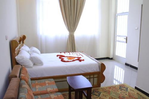 A bed or beds in a room at Avi Pension