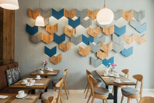 A restaurant or other place to eat at Avena Boutique Hotel by Artery Hotels