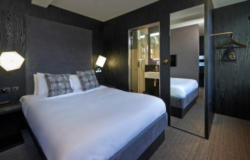 A bed or beds in a room at Bloc Hotel Birmingham