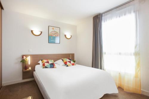 Un ou plusieurs lits dans un hébergement de l'établissement Appart'City Marseille Euromed
