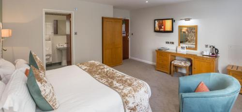 A bed or beds in a room at Best Western Moores Central Hotel