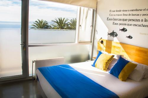 A bed or beds in a room at Verso Hotel