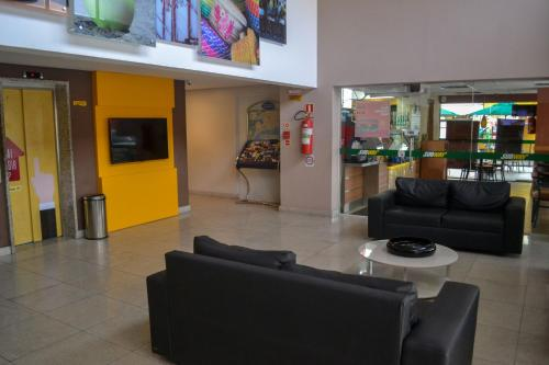 The lobby or reception area at EXPRESSO R1 HOTEL