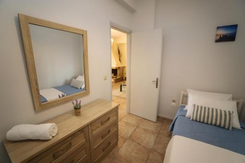 A bed or beds in a room at Philoxenia Family Suite