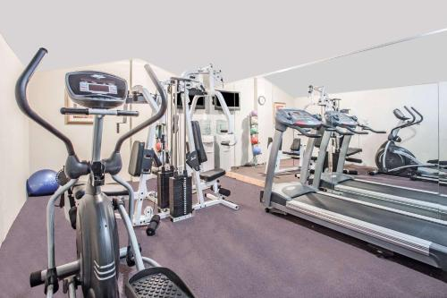 The fitness center and/or fitness facilities at Super 8 by Wyndham Camp Springs/Andrews AFB DC Area
