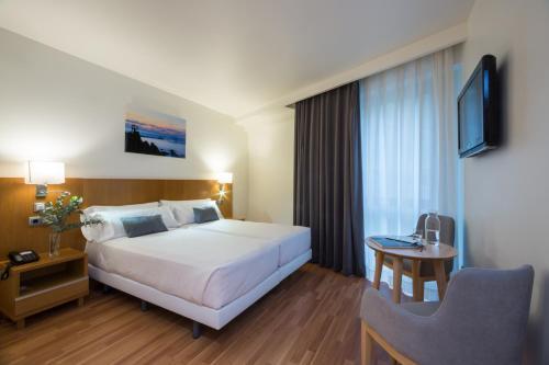 Cama o camas de una habitación en Hotel Palacio de Aiete