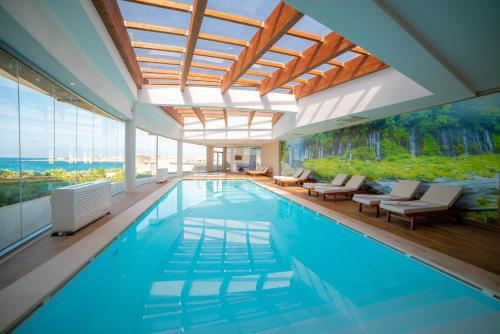 The swimming pool at or near Ramla Bay Resort