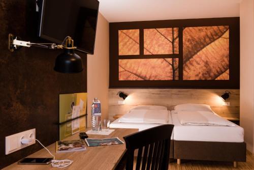 Ein Bett oder Betten in einem Zimmer der Unterkunft JUFA Hotel Fürstenfeld