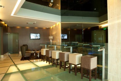 The lounge or bar area at TURIM Luxe Hotel