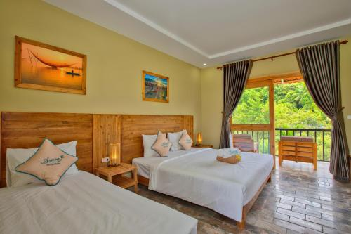 Кровать или кровати в номере Azura Resort
