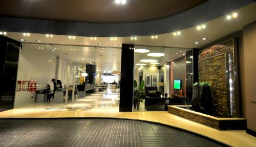 The fitness center and/or fitness facilities at Hotel Bicentenario Suites & Spa