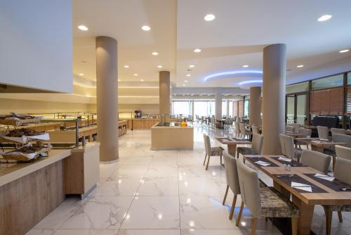 A restaurant or other place to eat at Poseidon Resort Hotel