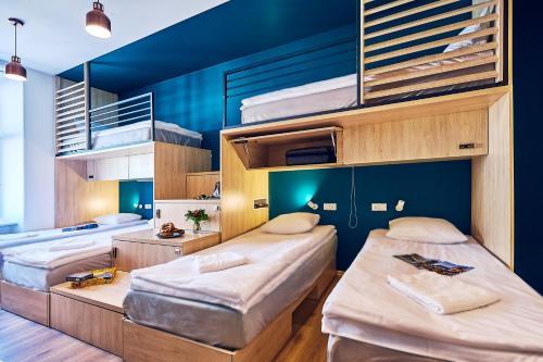 Un ou plusieurs lits dans un hébergement de l'établissement Draggo House