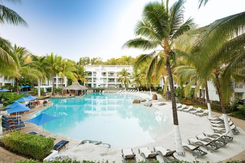 The swimming pool at or near Palm Cove Paradise - Couples spa beach getaway